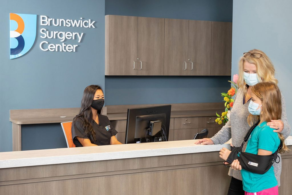 patient arriving at Brunswick Surgery Center check-in desk